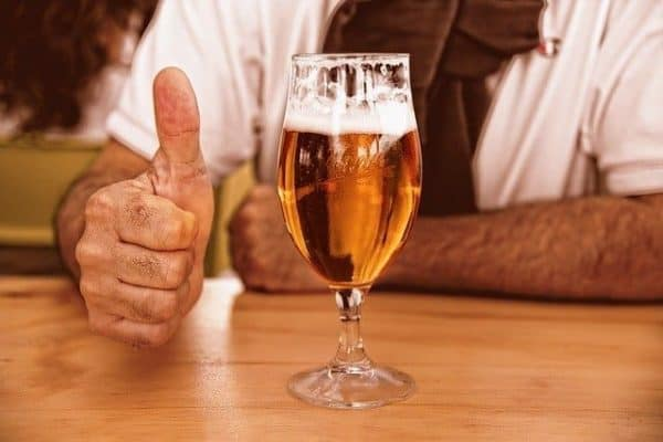 thumbs up with beer